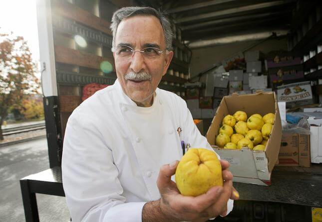 """Chef Faz Poursohi checks the fresh quince from Fresno that he buys from """"Uncle"""" Ray Nazari of Valley Fresh Produce and Groceries outside of Faz Restaurant and Bar in San Jose, Calif., on Wednesday, Dec. 9, 2015. Faz uses the quince to make quince preserves. (LiPo Ching/Bay Area News Group)"""